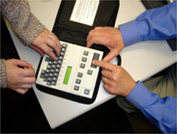 Face to Face communciation with a screen braille communicator.